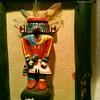 Kachina dolls, carved wooden walking stick
