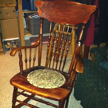 Press back griffin spindle rocking chair