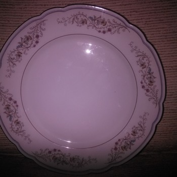 China plate, pink, blue, yellow flowers with brown & blue lines on rim