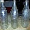 3 coke bottels no idea