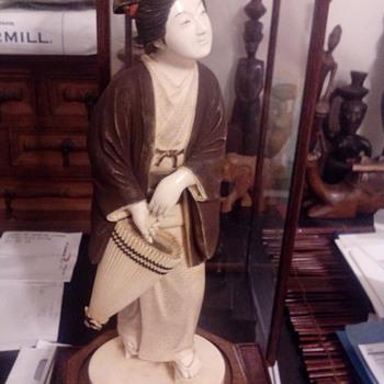 Geisha Statue 26cm height, teak wood stand and glass case,circa 1880s