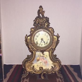 Rococo style gilt metal ansonia mantel clock with  cupid  - Clocks