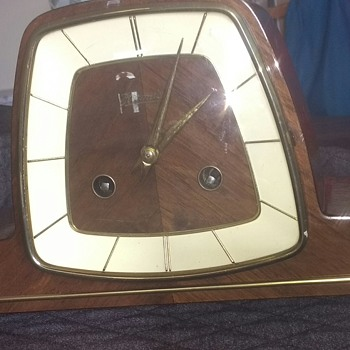 German 1970's clockwork clock with an Art Deco influence, wood, brass and other materials working condition.