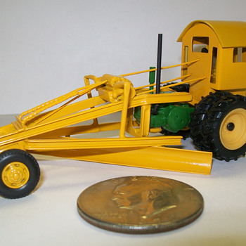 1/64th scale 1931 John Deere D /Hawkeye Motor Patrol grader and a Goodee Cadillac