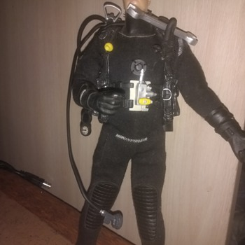 A scuba hero with a big Spanner? Found this along with a few 90s action men figure but hes short and slimmer - Toys