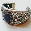 Antique silver repoussé lapis Asian cuff bangle, kyratised.