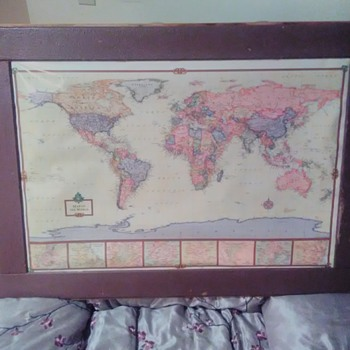 World map in hand made old recovered wood frame.