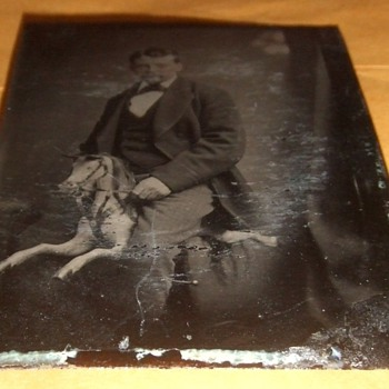 Tintype of man on carved rocking horse - Photographs