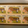 Framed stamps one with us postal license sticker on back