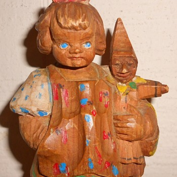 Wood carved doll holding elf doll - Figurines