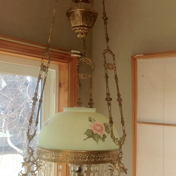 Elaborate hanging brass oil lamp with Center counter weight