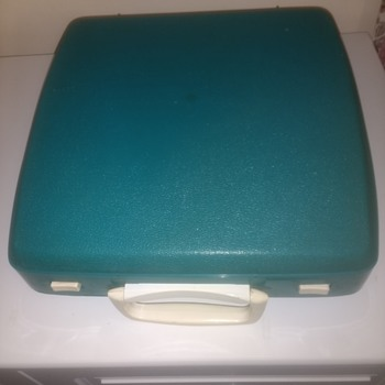 A Smith Corona Zephyr II Green and Cream typewriting machine with intergrated lid - Office