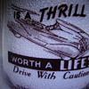 "Wilson's Mello ""D"" Milk Quart Milk Bottle With Safe Driving Slogan #2"
