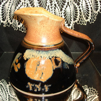 Black and Tan/Rust Pottery Pitcher - Pottery