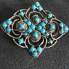 Silver tine and turquoise color beaded pin