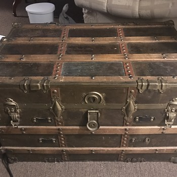 A nice trunk that looks like an antique to me!  - Furniture