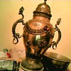 Large brass urn with dragon serpent handles