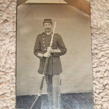 Tintype of 1880s US soldier with unusual rifle
