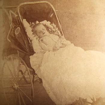 Tragic postmortem of young child in carriage - Photographs