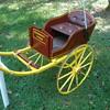 restored childs goat cart