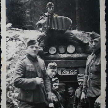 cosy in the wartime, advertising the enemy  - Coca-Cola