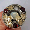 Antique Arts and Crafts brooch, garnets, moonstone, silver and golden leaves.
