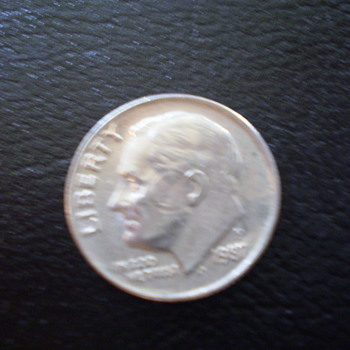 1987P Dime with circle around cheek and effecting the ear,  - US Coins
