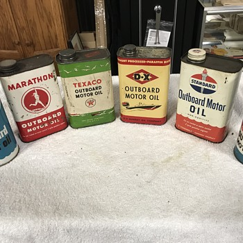 Collection of outboard motor oil cans  - Petroliana