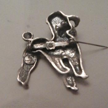 back of Napier brooch