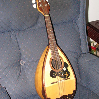 A suzuki Mandolin made by Kiso Suzuki Violin co. L.T.D. Japan.  I believe it was made in the early 1900's.   - Guitars