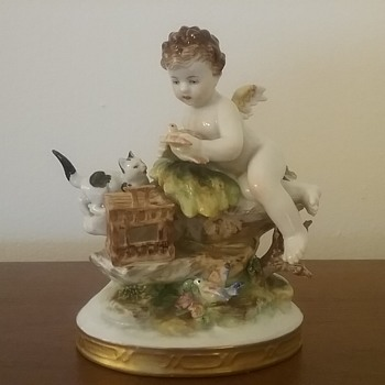 Dresden Volkstedt cherub with animals