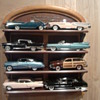 Cars of the fifties....Can you spot the plastic promo car?