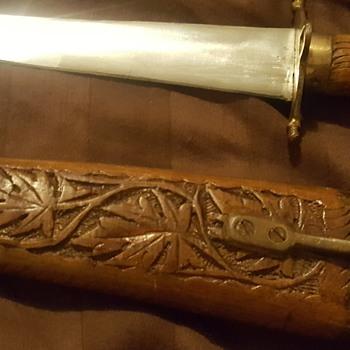 Old wood carved dagger