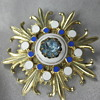 Gold-Tone & Enamel Starburst Brooch with Partly Hidden Letters