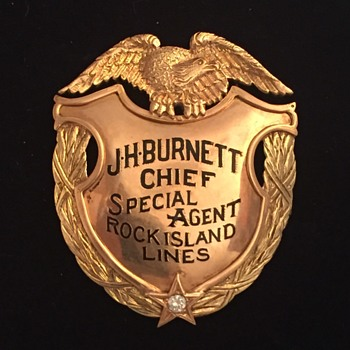14k gold with diamond badge and presentation 44 caliber gun belonging to Chief Special Agent John Burnett - Railroadiana