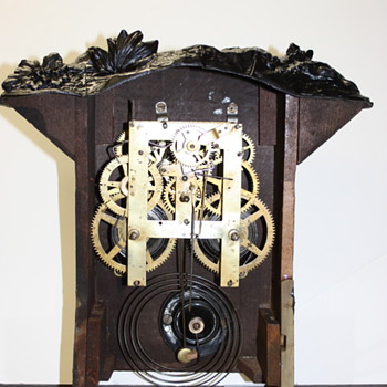 N. Mullers Sons Iron Front #167 - Clocks