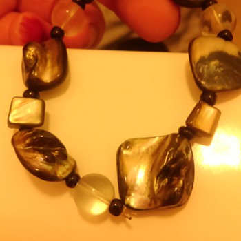 Mother of pearl i think - Costume Jewelry