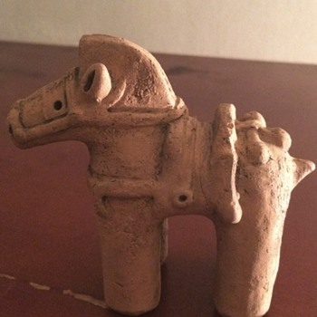 I have no clue where and what time period this little horse is from can anyone help?