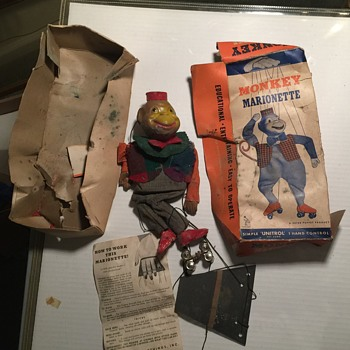 old monkey on roller skates hand puppet - Dolls