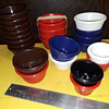 collection of colorful condiment cups
