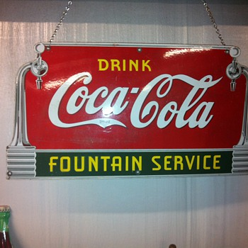 Coca Cola sign from 39, Buick wheels from the 20's,Toms peanut cabinet from 50's - Coca-Cola