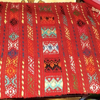 bright colored textile with fringe