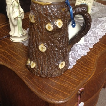 Tree log mysterious majolica pitcher