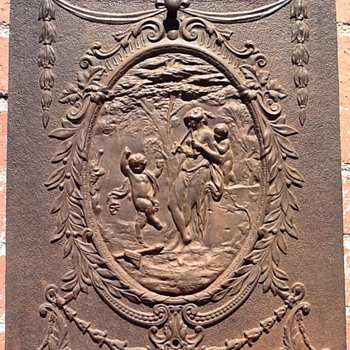 ornate iron fireplace cover - Victorian Era