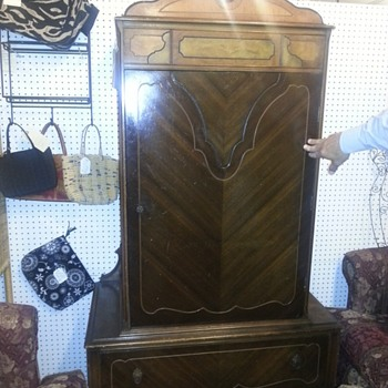 I believe this to be a waterfall wardrobe made by the Lenoir Furniture Corporation. - Furniture