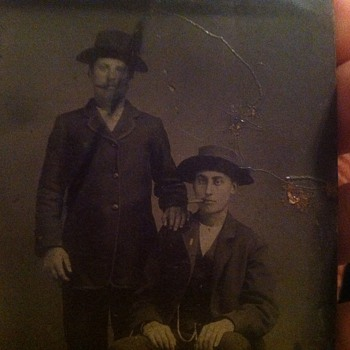 Tintype of two men with cigars