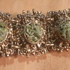 Antique bronze chipped stone accents