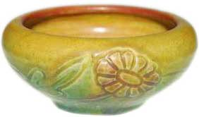 Small bowl with incised and painted decoration of dandelions going all around, the work of Charles Stewart Todd in 1913