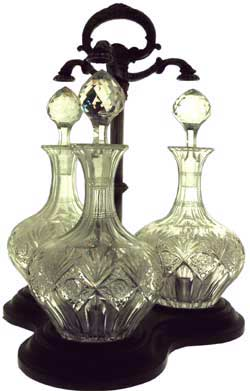 "This is locking Tantalus of three decanters by T.G.Hawkes & Company in the pattern ""Brunswick"""