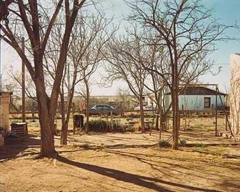 """Stephen Shore (1947- ) """"Desert Street, Van Horn, Texas."""" Chromogenic print 1975; printed 1978"""